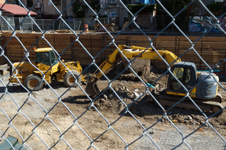 Construction equipment is seen near South Crouse Avenue as work continues to level the land before building a multilevel student housing project. Photo taken Aug. 8, 2017